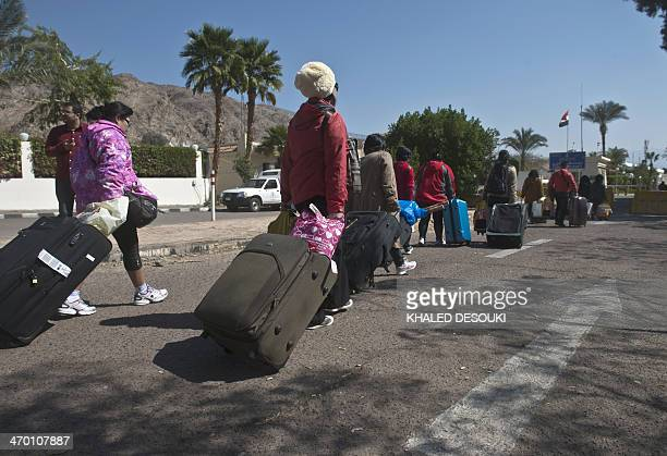 Tourists depart Egypt via the Taba Land Port crossing on February 18 two days after a tourist bus exploded in the Egyptian south Sinai resort town...