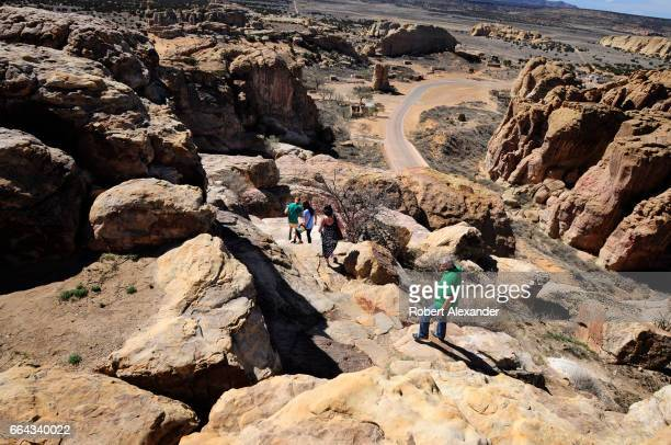 Tourists descend an ancient path leading down from Sky City one of three Native American villages which make up Acoma Pueblo west of Albuquerque New...