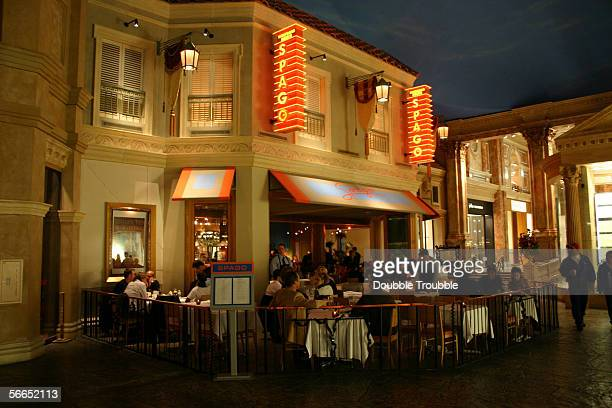 Tourists dine at Wolfgang Puck's Spago restaurant in the Forum Shops at Caesars Palace Hotel and Casino January 9 2006 in Las Vegas Nevada