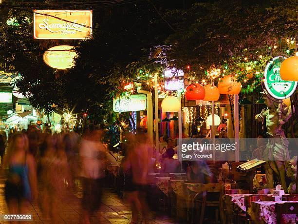 Tourists dining by restaurants along Khao San Rd