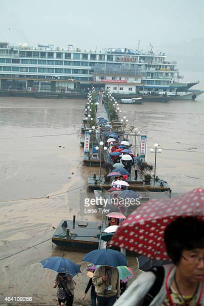 Tourists disembarking form a Victoria Cruises ship at Fengdu otherwise known as 'Ghost City' a cultural site in the Yangtze River's Three Gorges An...