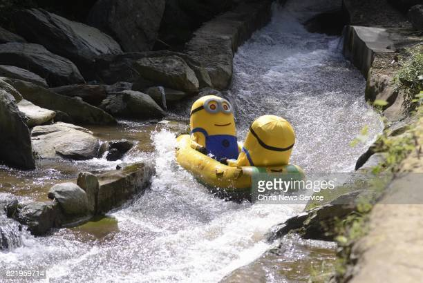 Tourists dressed as Minions drift in a river at Lianyuan on July 24 2017 in Loudi Hunan Province of China Tourists in the Minions costumes enjoyed...