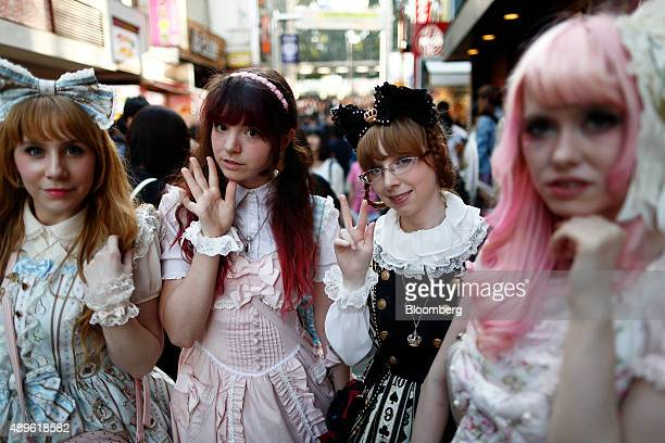 Tourists dressed in cosplay outfits pose for a photograph on Takeshita Street in the Harajuku area of Tokyo Japan on Tuesday Sept 22 2015 The Bank of...