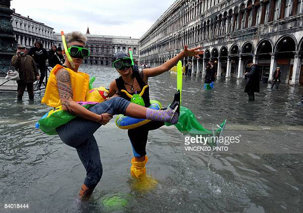 Tourists dressed with scuba diving outfits parade on Piazza San Marco during floods on December 13 2008 in Venice The acqua alta stood at 109...