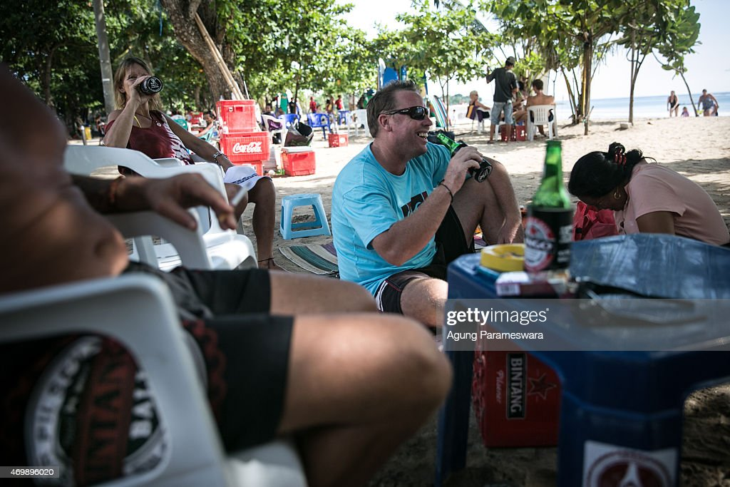 Tourists drink Bintang beers at Kuta Beach on April 16, 2015 in Kuta, Bali, Indonesia. Indonesia, on April 16, banned small retailers from selling beer which is proposed that legislation by two Islamic parties-the Prosperous Justice Party and the United Development Party-that would ban all consumption of alcoholic drinks and bring jail terms of up to two years for offenders in Indonesia, home to the world's largest Muslim population. The regulation states that it is needed to protect public morals and culture and to improve the control and supervision of alcohol production, distribution and sales. There had been particular anxiety about how the ban might affect tourism on the Hindu-majority resort island of Bali. However, Indonesian trade minister Rachmat Gobel, who was shouted at during an ill-tempered meeting with community leaders in Bali last weekend, has now pledged to ease the restrictions on the island to ensure street vendors can still sell beer at the beach.