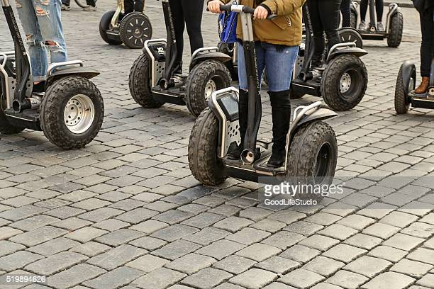 Tourists driving segways