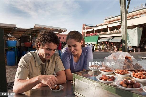 Tourists eating at a food stand