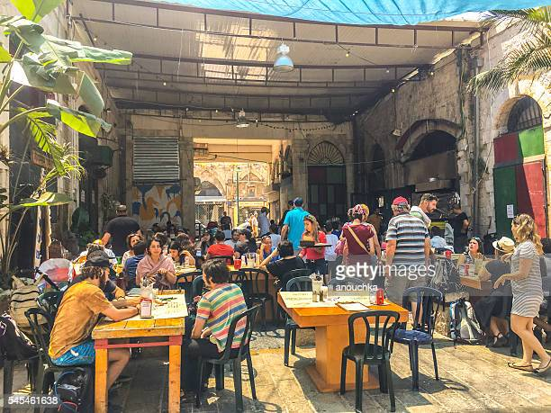 Tourists eating in outdoor cafe, Tel Aviv Yafo, Israel