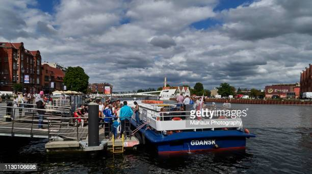 tourists embark on a river cruise on the river motlawa in gdansk. - motlawa river stock pictures, royalty-free photos & images