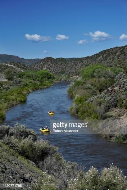 Tourists enjoy a raft ride on the Rio Grande as it flows south through New Mexico near Taos