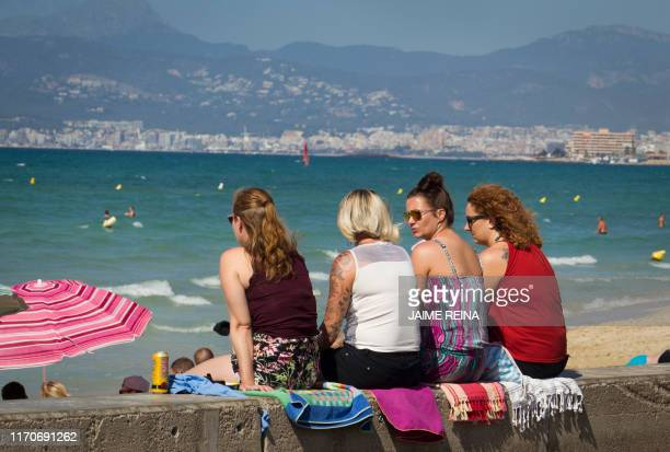 Tourists enjoy a sunny day at the Playa de Palma beach in Palma de Mallorca on September 24 2019 Britain has repatriated ten percent of nationals who...