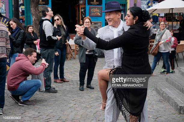 Tourists enjoy a tango show at to the traditional street museum Caminito in La Boca neighbourhood in Buenos Aires on September 14 2018 Foreign...