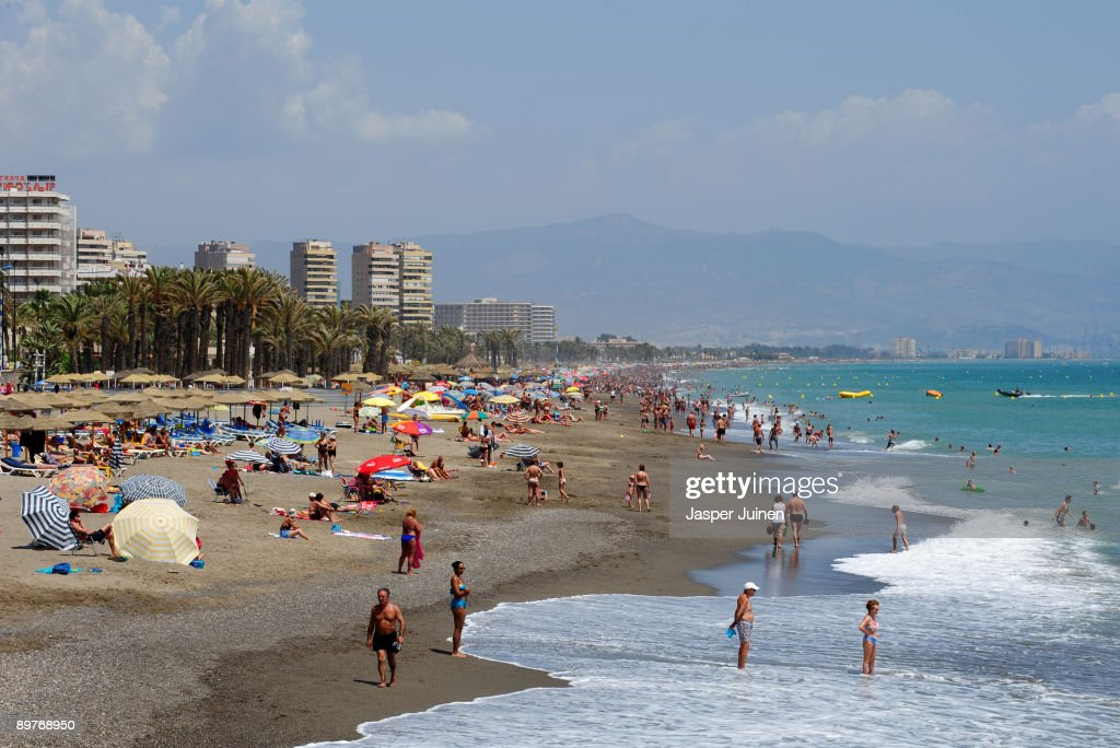 Tourists enjoy a usually packed Costa del Sol Carihuela beach on August 12, 2009 in Torremolinos, Spain. Altough Spanish resorts remain busy, receiving 23.6 million foreign visitors in the first half year, the economic downturn has seen more than an eleven percent drop in visitors, especially from Britain, over the same period as last year. European holidaymakers are increasingly staying at home for their annual holidays.