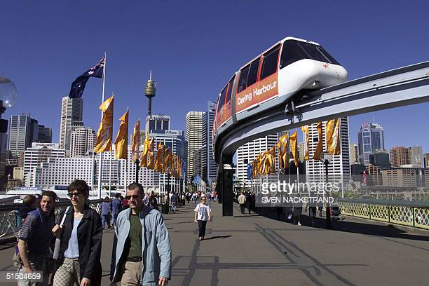Tourists enjoy a walk around Sydney's Darling Harbour 10 September 2000 five days before the opening of the 2000 Summer Olympics