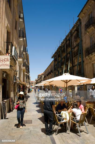Tourists enjoy al fresco dining in one of the small cafes in one of the many narrow pedestrian only streets and alleyways in the center of this...
