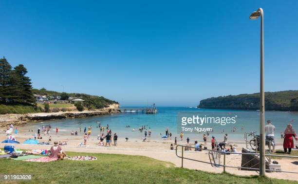 port campbell, australia - january 27, 2018: tourists enjoy at waterfront of port campbell, a good stop, beautiful beach in the central of great ocean road. - helicopter photos stock pictures, royalty-free photos & images