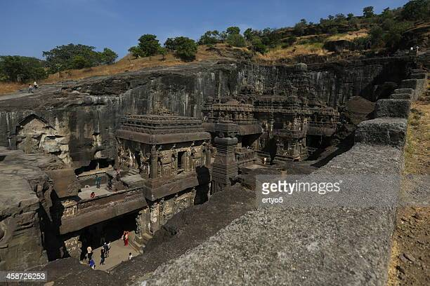 tourists enjoy carvings at the ellora caves - ellora stock pictures, royalty-free photos & images