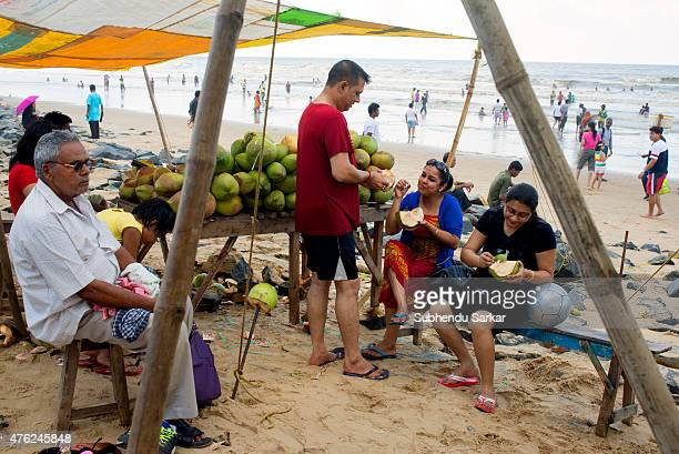 Tourists enjoy coconut water and pulp on Digha sea beach Digha in East Midnapore district of West Bengal is a seaside resort town about 187 kms from...