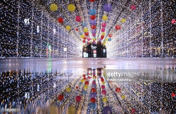 YANGZHOU CHINA JANUARY 16 2020 Tourists enjoy colorful lights in the light tunnel Yangzhou City Jiangsu Province China January 16 2020 PHOTOGRAPH BY...