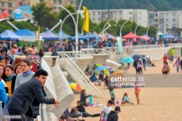 Tourists enjoy Dichato Beach Chhile 519kms south of Santiago de Chile on February 24 where retaining walls have been built against tsunamis A decade...