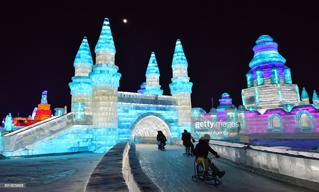 Tourists enjoy ice track cycling as they ride through an illuminated ice castle during the 33rd Harbin International Ice and Snow Festival at Harbin Ice And Snow World in Harbin, China on January 16, 2017. The Festival, established in 1985, is held annually on January 5 and lasts over a month.