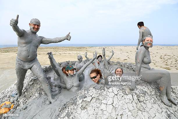 Tourists enjoy mud bath inside a crater of the mud volcano in Gobustan, about 65 km southwest of Baku, Azerbaijan on June 09, 2015.