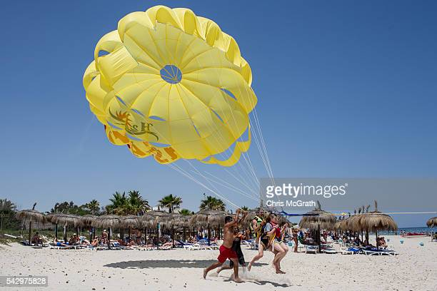 Tourists enjoy parasailing on June 25 2016 in Sousse Tunisia Before the 2011 revolution tourism in Tunisia accounted for approximately 7% of the...