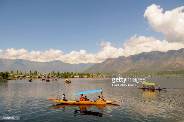 Tourists enjoy shikara ride on the waters of Dal Lake during a sunny day on April 12 2018 in Srinagar India