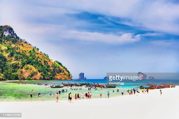 Tourists enjoy sightseeing scenic seascape on white sand ridge at Talay Waek White Sand Ridge in Summer, Poda Island, Krabi Province, Thailand