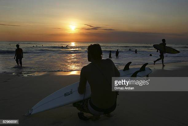 Tourists enjoy sunset on Dreamland beach May 22 2005 in Bali Resort Island Indonesia Total of 146 million foreign travelers visited Bali in 2004 and...