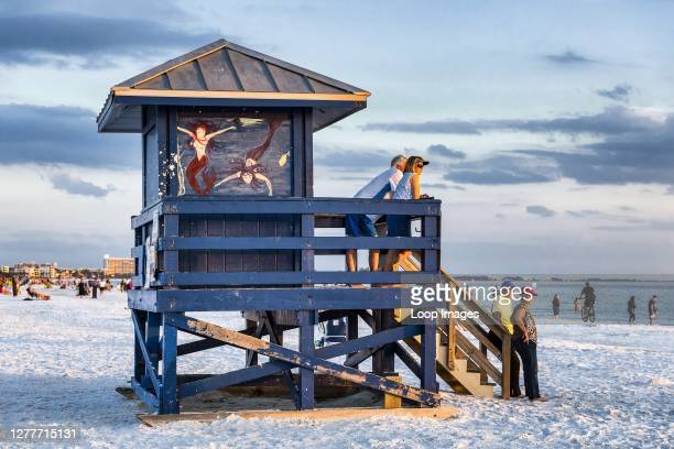 Tourists enjoy sunset view at Siesta Key Beach in Florida.