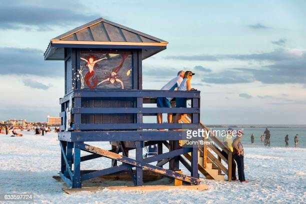 Tourists enjoy sunset view at Siesta Key Beach.