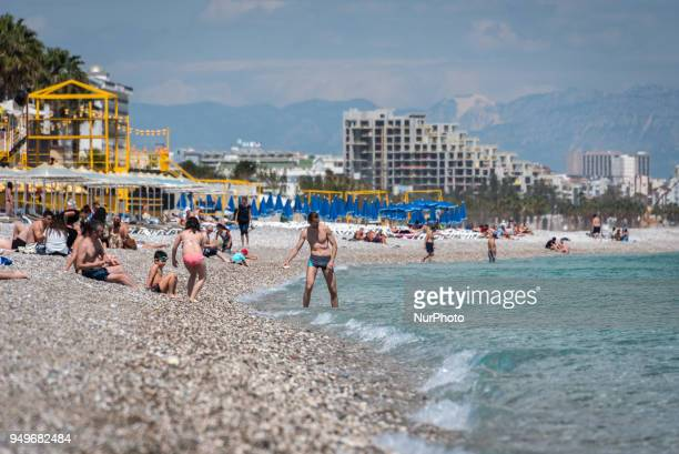 Tourists enjoy sunshine and clear blue Mediterranean waters on the beaches of Antalya a tourism hub on the southern coast of Turkey which is...