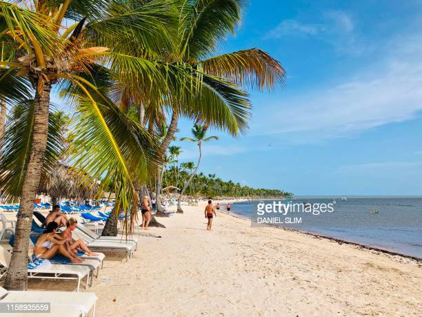 Tourists enjoy the beach in Punta Cana Dominican Republic on August 1 2019