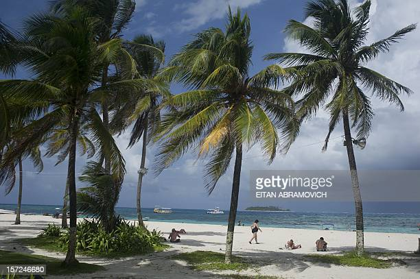 Tourists enjoy the beach in San Andres Island Colombia on November 30 2012 Colombia on Wednesday said it would no longer recognize the International...