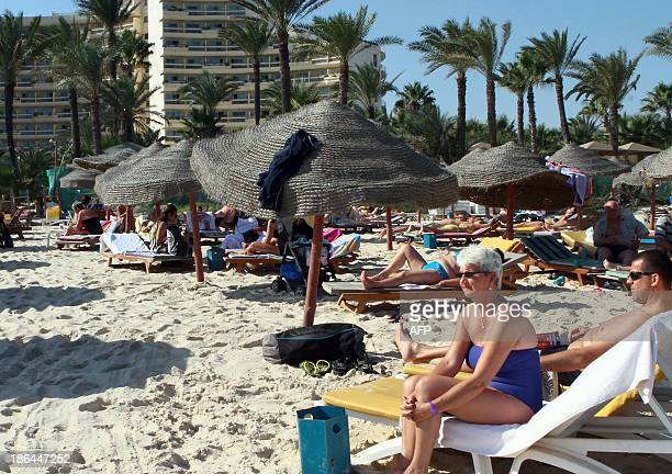 Tourists enjoy the beach near a fourstar hotel in the resort town of Sousse a popular tourist destination 140 kilometres south of the Tunisian...
