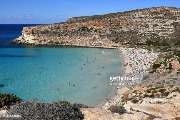 Tourists enjoy the beach of the Isola dei Conigli in Lampedusa on September 27 2018 Five years after the worst shipwreck of its history the largest...