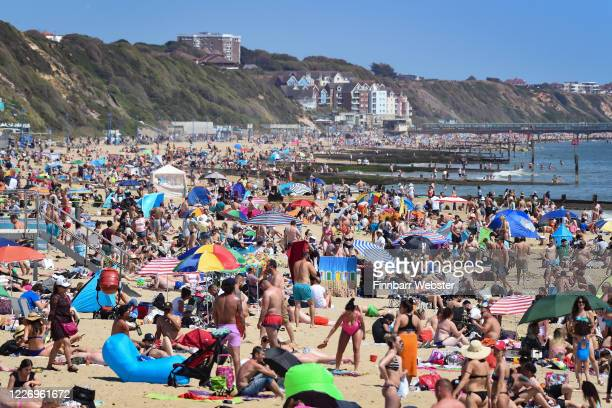 Tourists enjoy the hot weather at Bournemouth beach on May 25 2020 in Bournemouth United Kingdom The British government has started easing the...