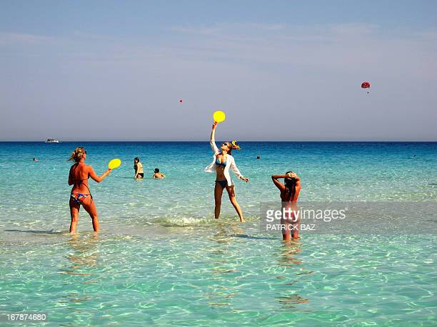 Tourists enjoy the Labour Day at Ayia Napa's Nissi beach on May 1 2013 in Cyprus AFP PHOTO / PATRICK BAZ