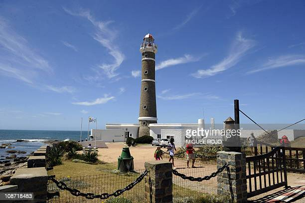 Tourists enjoy the lighthouse in Jose Ignacio Maldonado 180km east of Montevideo on January 18 2011 AFP PHOTO/Miguel ROJO