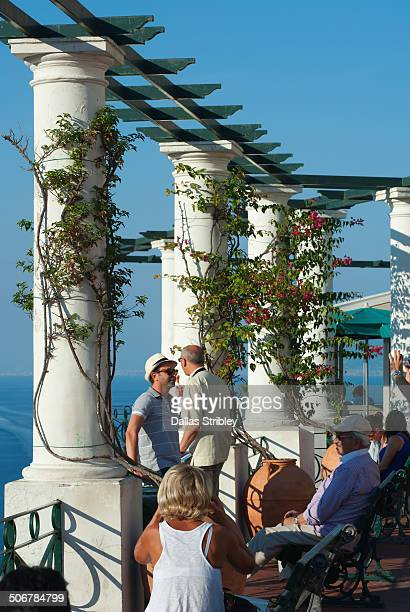 Tourists enjoy the sea-view at Piazza Umberto