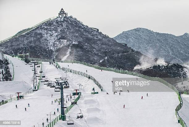 Tourists enjoy the snow during the trial operation of a new ski resort on November 25 2015 in Beijing China Chinese cities Beijing and Zhangjiakou...