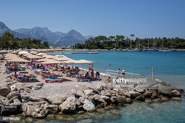 Tourists enjoy the suna at a beach on July 11 2016 in Antalya Turkey Russian President Vladimir Putin last month officially lifted travel...