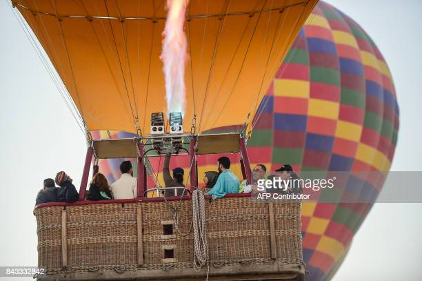 Tourists enjoy the view from a hot air balloon during a flight over Nevsehir in Turkey's historical Cappadocia region Central Anatolia eastern Turkey...