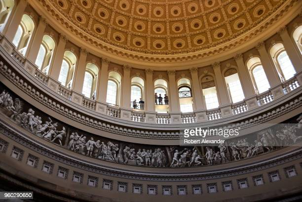 Tourists enjoy the view of the Rotunda below from the inner dome of the US Capitol in Washington DC