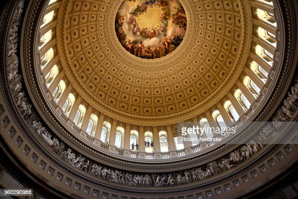 Tourists enjoy the view of the Rotunda below from the inner dome of the US Capitol in Washington DC The dome features a fresco by Constantino Brumidi...