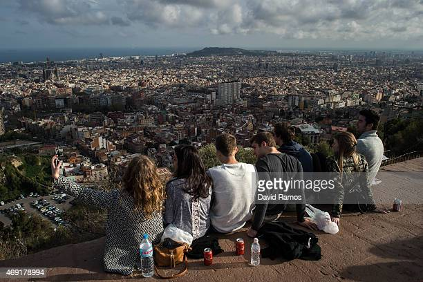 Tourists enjoy the views over the city on April 10 2015 in Barcelona Spain Barcelona's city hall has put a regulation in motion that bans large...