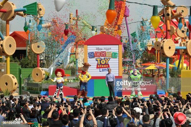 Tourists enjoy themselves at Disney Pixar Toy Story Land as part of Shanghai Disney Resort on April 26 2018 in Shanghai China Based on Pixar's Toy...