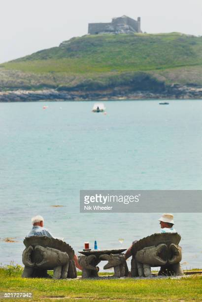 tourists enjoy view of old grimsby harbor on tresco - isles of scilly stock pictures, royalty-free photos & images
