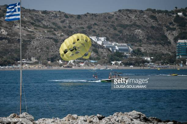 Tourists enjoy watersports at Faliraki Bay in the Aegean island of Rhodes on August 29, 2020. - Rhodes island, one of the mass tourism Greek islands...